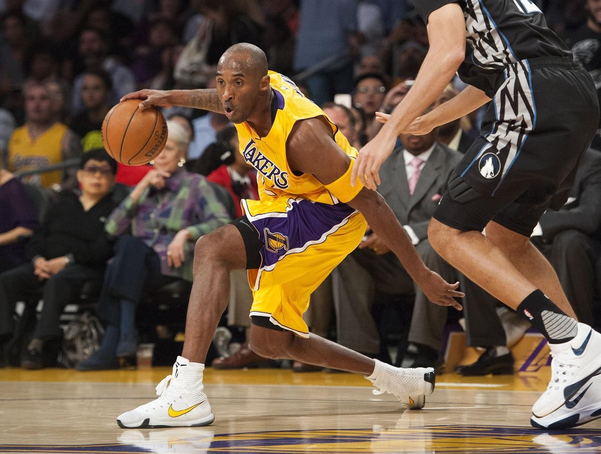 The Lakers' Kobe Bryant dribbles around the Timberwolves' Tayshaun Prince during the first half of the Lakers' season opener at Staples Center Wednesday night.  ///ADDITIONAL INFO:     lakers1029.kjs  ---  Photo by KEVIN SULLIVAN / Orange County Register  --  10/28/15  The Los Angeles Lakers open their 2015-16 season against the Minnesota Timberwolves Wednesday night.    10/28/15